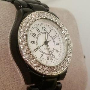 Womens diamond bezel mother of pear face watch